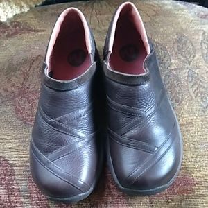Merrell brown shoes. Slip ons size 9.